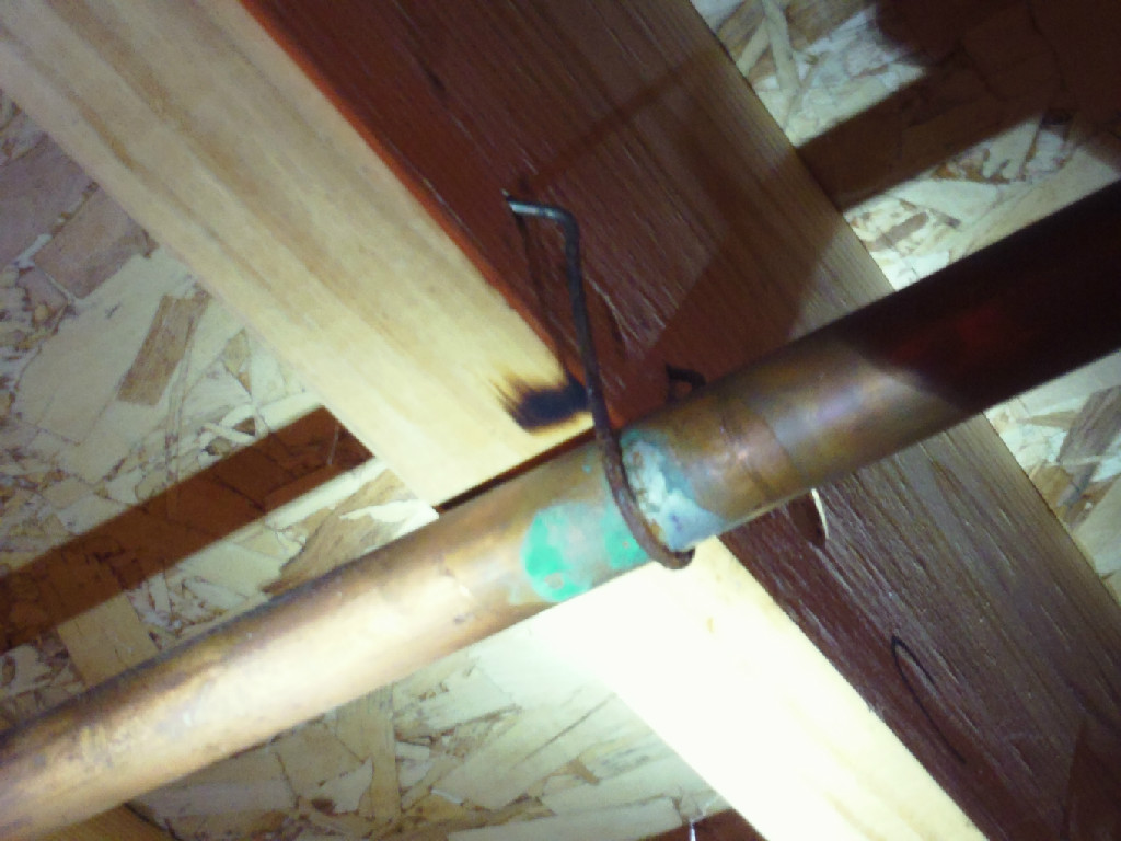 Copper water lines are being improperly supported by steel hangers